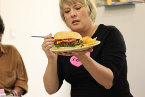 Cindy Puts the Final Touches on the Hamburger
