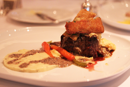 Grilled Tenderloin of Beef with Lobster Ragout, Bearnaise Sauce, Swiss Chard, Celeriac Gratin