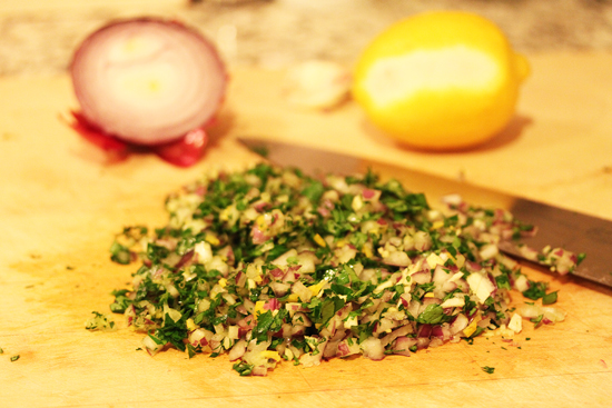 First you mince the Sofrito ingredients: onion, Italian flat leaf parsley, garlic and lemon zest.