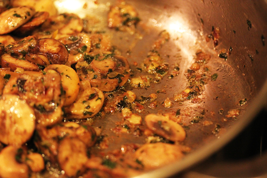 Cook until the mushrooms release their liquid and it evaporates, leaving caramelized bits on the bottom of the pan.