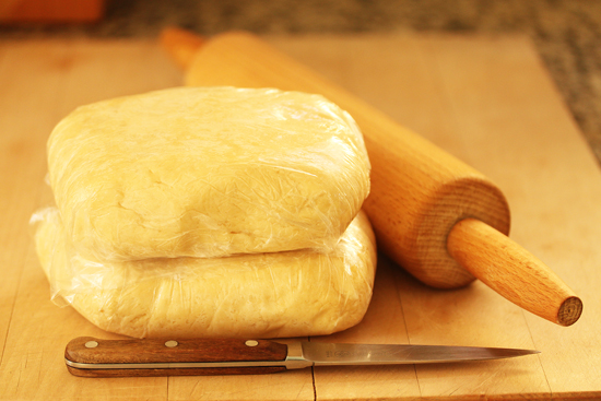 After the dough is made, it is divided in two, wrapped in plastic and refrigerated.