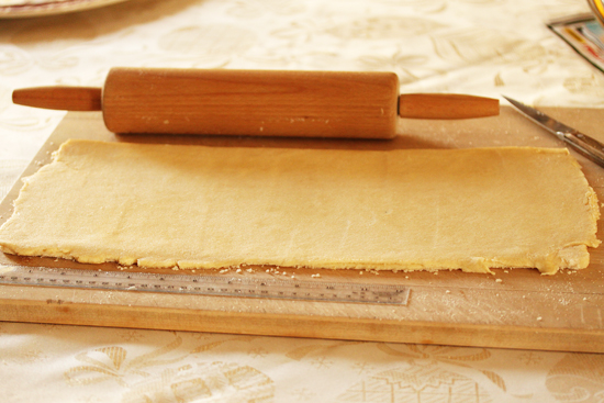 The dough is rolled out over half the vanilla sugar and the excess around the edges is scooped up and rolled in on top.